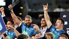 Patrick Tuipulotu of the Blues holds up the trophy following the Super Rugby Transtasman final. (Photo / Getty)