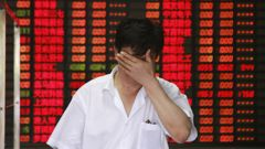 A trader at the Shanghai Stock Exchange (Getty Images)