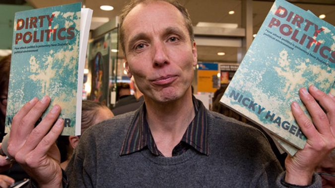 Nicky Hager with copies of his book Dirty Politics (NZ Herald)