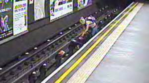 PHOTOS: Child rescued from London tube tracks