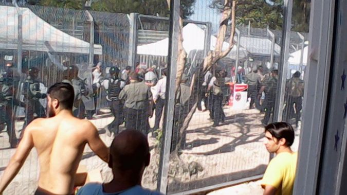 Riot place charge Manus Island detention centre during a hunger strike, January 16, 2015. Around 500 starved themselves while 30 sewed their lips together.