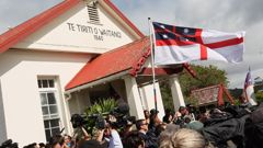 The Independent Tribes of Aotearoa flag flying at Waitangi (Getty Images)