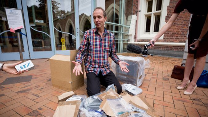 Nicky Hager with his destroyed computer outside Auckland High Court today (NZH).