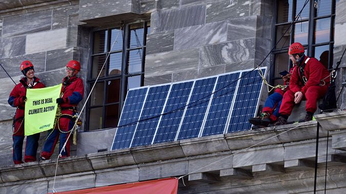 Greenpeace protesters, who used modern technology to scale the facade of New Zealand's Parliament (Supplied)