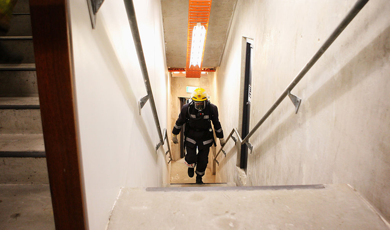A firefighter races up the steps of the Sky Tower (Getty Images)