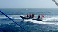 In this file photo from October 2015, a Chinese Coast Guard boat circles a Filipino fishing boat near Scarborough Shoal in the South China Sea. Photo / AP / NZ Herald