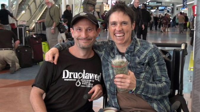 Arik Reiss and Rebecca Reider at Auckland International Airport with Reider's medicinal cannabis prescription, which she brought through customs (Druglawed/Facebook)