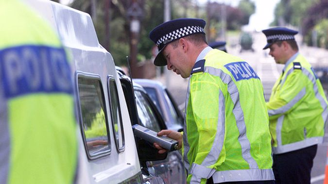 Police officers breath-testing drivers. Photo / File