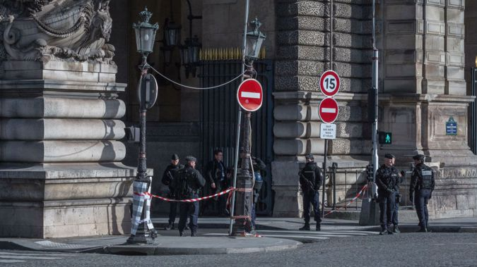 Police secure the scene outside the Louvre (Getty Images)