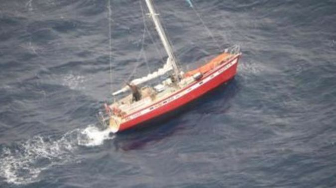 The relieved yachtie waving furiously to Orion crew from his stricken vessel. Photo / Supplied