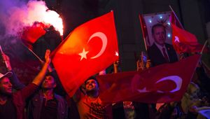 'Yes' vote supporters hold a portrait of President Tayyip Erdogan (Getty Images)