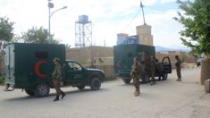 Taliban kill at least 140 in military base attack