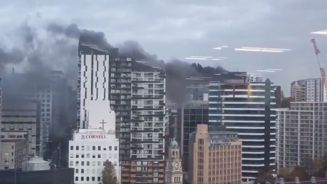 High rise building on fire sends smoke over Auckland CBD