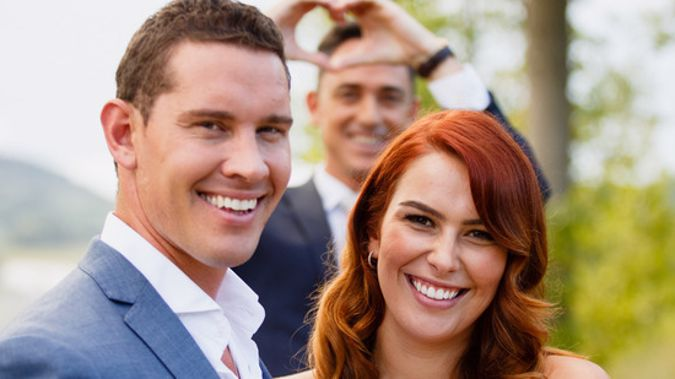 The Bachelor's winning couple Zac Franich and Viarni Bright, with host Dominic Bowden in the background. (NZH)