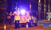 Police stand at a cordoned-off street close to Manchester Arena (Photo / AP)
