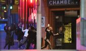 People run from the Lindt Cafe, Martin Place during a hostage standoff on December 16, 2014 in Sydney, Australia. (Getty)