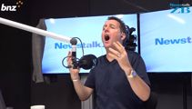 Mike Hosking reacts to Team New Zealand's capsize