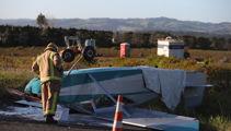 Pilot survives plane crash on busy Auckland road