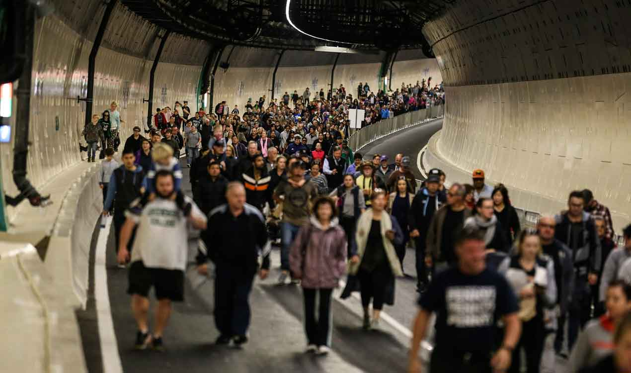 Members of the public walk through the Waterview tunnel (Getty Images)