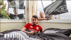 British and Irish Lions tourist Lucas Mac Eachrain, from Dublin, with his Napier hosts Soggy Rogers and Richard Frings, from Westshore in Napier. Photo / Paul Taylor
