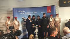 Members of Team NZ with the America's Cup at Auckland Airport (Photo / Vaimoana Tapaleao).