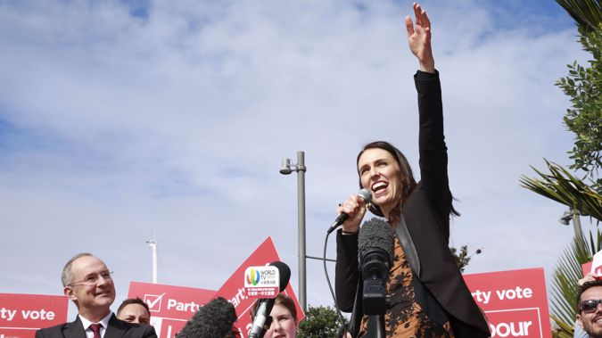 Labour leader Jacinda Ardern addresses a crowd in downtown Auckland, where she announced the party's transport plan for the city. Photo / Nick Reed
