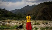 A woman tends to her goats in the remote village of Phalame in Kathmandu, Nepal. (Getty)