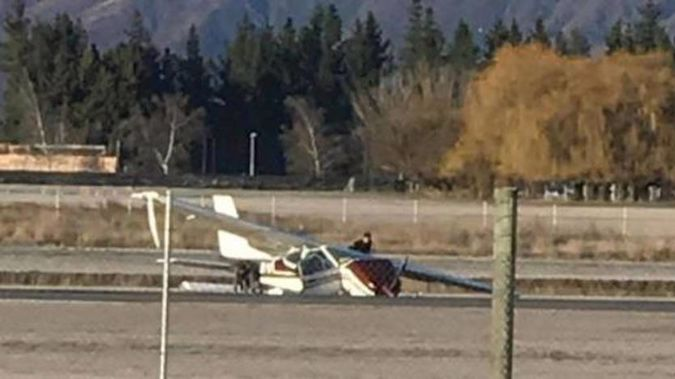 Emergency services are responding to an incident at Queenstown Airport where a small plane crashed this morning. Photo / Mauro Ramirez Andaur