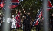 A KKK protest against the removal of a statue of Confederate General Robert E. Lee in Charlottesville, Virginia in July (Getty Images)