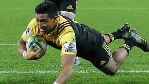 Julian Savea dives in to score for the Hurricanes. Photosport