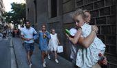 People flee the scene in Barcelona in Barcelona. (Photo / AP)