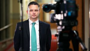 Green co-leader James Shaw prepares for a television interview following the resignation of co-leader Metiria Turei at Parliament on August 9, 2017 in Wellington, New Zealand. Getty Images.