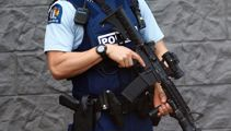 Armed police swoop on Auckland street in hunt for Rollie Heke
