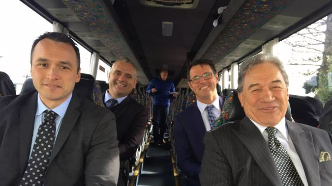 New Zealand First leader Winston Peters aboard his campaign bus with MPs Darroch Ball (left), Fletcher Tabuteau (rear left) and Clayton Mitchell (rear right). (Photo / Claire Trevett)