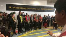 Watch: Black Ferns land at Auckland Airport