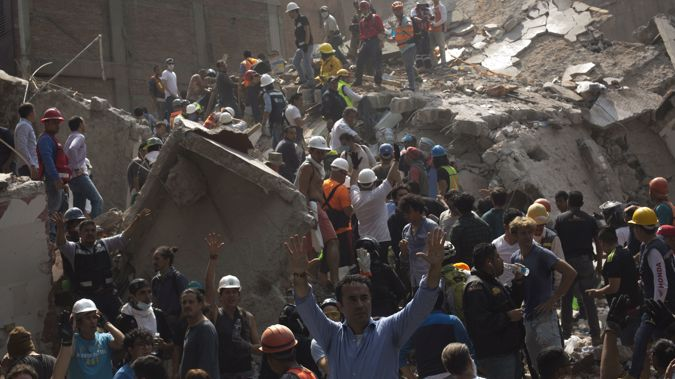 The earthquake struck on the 32nd anniversary of a temblor that killed thousands in the capital.