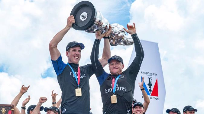 Team New Zealand helmsman Peter Burling and skipper Glenn Ashby hold aloft the America's Cup. (Photo \ Photosport)