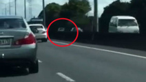 Watch: Car speeds wrong way up Southern Motorway
