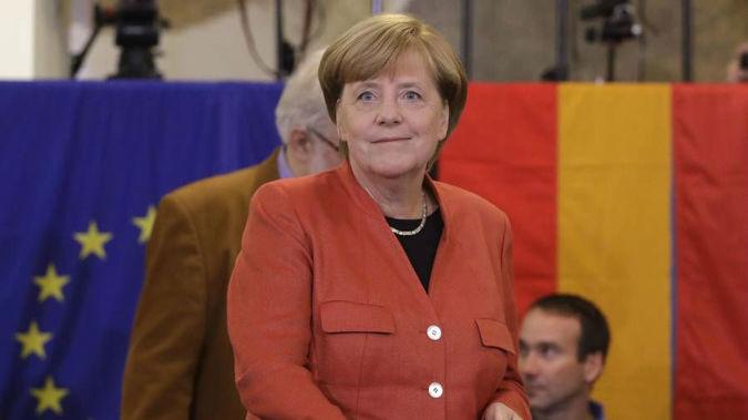 German Chancellor Angela Merkel casts her vote in Berlin, Germany. (Photo / AP)