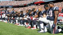 Over 100 NFL players kneel for US anthem