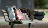 Homeless person sleeping on a park bench at Victoria Park, Auckland (Photo \ Getty Images)