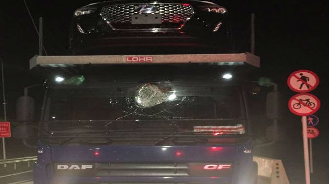 Police are calling for information after rocks and a pallet were thrown at vehicles on the Kapiti Expressway in the middle of the night. (Photo: Facebook)