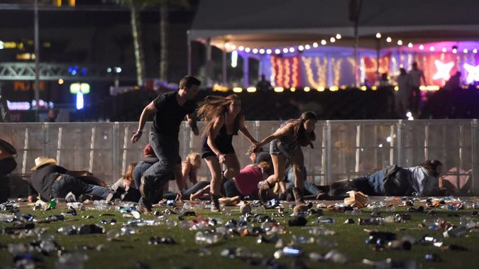 People run from the Route 91 Harvest country music festival after gun fire was heard yesterday. (Photo / AP)