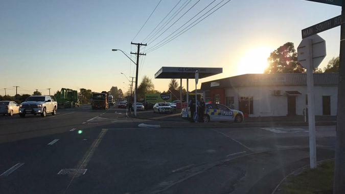 There is a massive police presence at a property in Christchurch this morning. (Photo \ NZ Herald)
