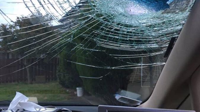 A rock hurled from an Auckland motorway overbridge has smashed into the windscreen of a taxi. (Photo / Supplied)