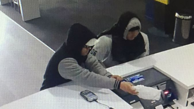 One of the men was described as wearing a light-coloured cap, shorts and sports shoes and a black and grey hoodie, while the other was wearing dark trousers, gumboots and a grey hoodie. (Photo: NZ Police)