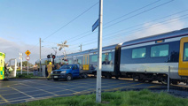 Traffic chaos after train and ute collide