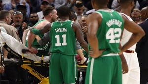 Kyrie Irving #11 of the Boston Celtics consoles Gordon Hayward (Photo \ Getty Images)