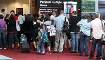 Lengthy queues and 'unsafe crowds' at chaotic Auckland Airport