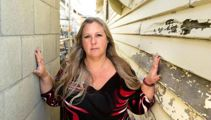 Homeowner in battle after townhouses built centimetres from her own